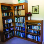 2 tall and 1 half size oak bookcases excluding books